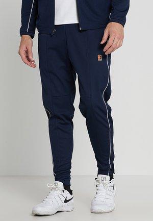 PANT - Pantaloni sportivi - obsidian/white