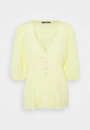 RISE - Print T-shirt - yellow