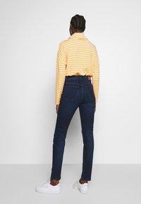 Marc O'Polo - TROUSER - Slim fit jeans - dark blue base wash - 2