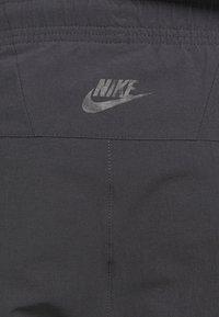 Nike Sportswear - FESTIVAL - Tracksuit bottoms - smoke grey/volt - 5