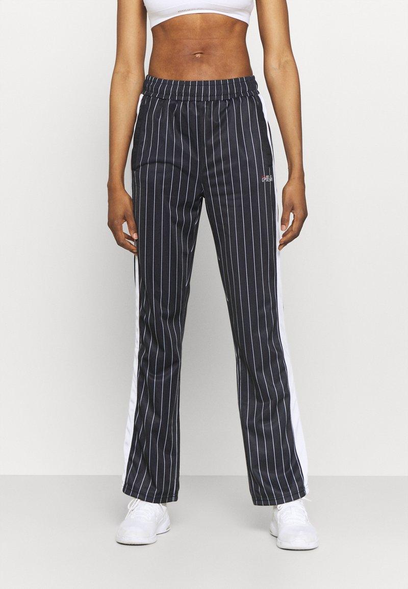 Fila - JAIMI PINSTRIPE TRACK PANTS - Teplákové kalhoty - black/bright white