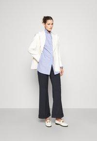 sandro - Button-down blouse - bleu ciel - 1