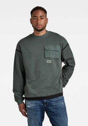 TAPE MESH - Stickad tröja - green
