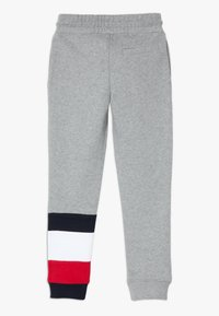 Tommy Hilfiger - GLOBAL STRIPE COLORBLOCK PANTS - Tracksuit bottoms - grey - 1