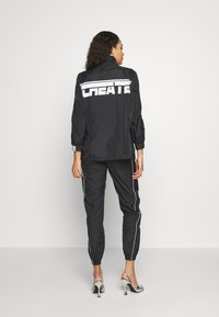 Missguided - CODE CREATE JACKET WITH REFLECTIVE PIPING - Bomber Jacket - black - 2