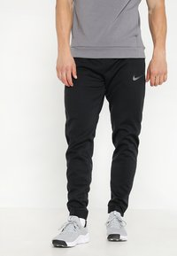 Nike Performance - THERMA SPHERE PANT - Tracksuit bottoms - black/anthracite/hematite - 0