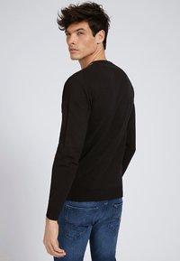Guess - Sweatshirt - schwarz - 2