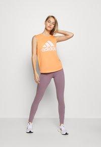 adidas Performance - MUST HAVES SPORT REGULAR FIT TANK TOP - Camiseta de deporte - ambtin/white - 1