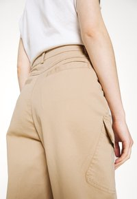 Karl Kani - RETRO PANTS - Trousers - sand - 3