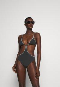 Calvin Klein Swimwear - CORE LOGO TAPE CUT OUT ONE PIECE - Plavky - black - 1