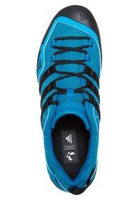 adidas Performance - TERREX SWIFT SOLO HIKING SHOES - Hiking shoes - dark solar blue/black - 6