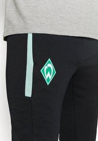 Umbro - WERDER BREMEN TAPERED PANT - Squadra - black/ice green - 4