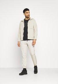 Columbia - SANTA ANA™ WINDPANT - Outdoor trousers - offwhite - 1