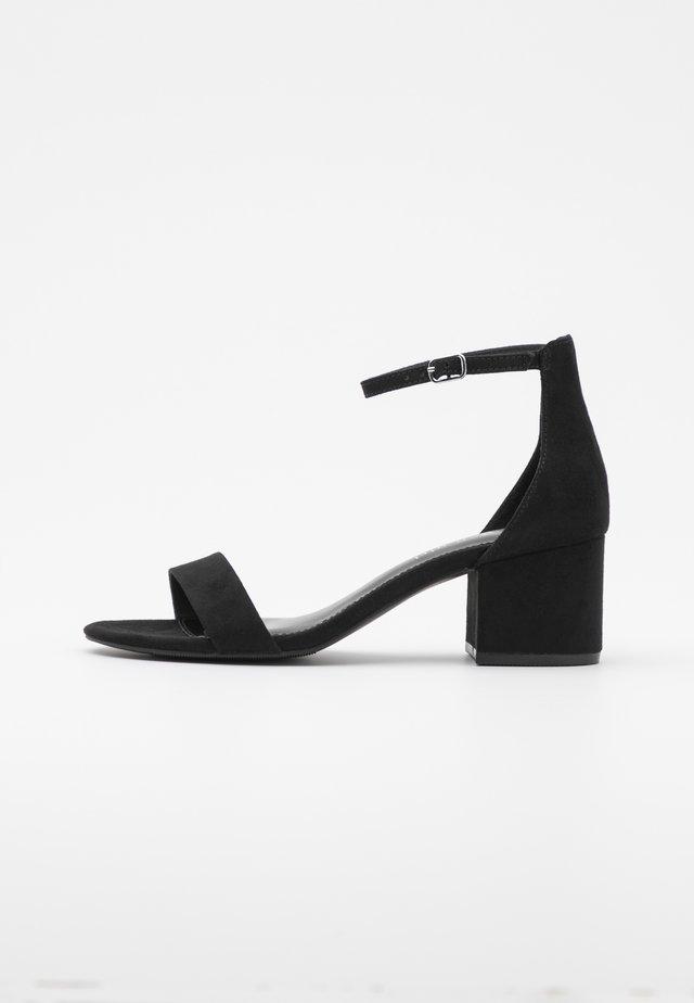 ILEANA - Sandaalit nilkkaremmillä - black