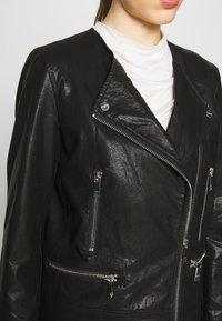 DKNY - MOTO JACKET - Faux leather jacket - black - 4