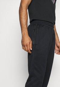 Nike Performance - SPOTLIGHT PANT - Tracksuit bottoms - black - 4