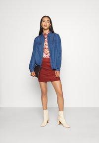 ONLY - ONLJULIE BONDED SKIRT - Mini skirt - fired brick - 1