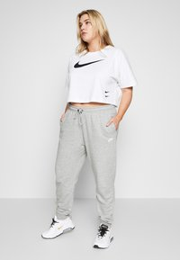 Nike Sportswear - PANT - Tracksuit bottoms - grey heather/white - 4