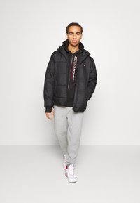 Tommy Hilfiger - CUFFED REGULAR PANT - Tracksuit bottoms - grey - 1