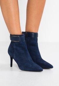 Calvin Klein - GITAR - High heeled ankle boots - dark navy - 0