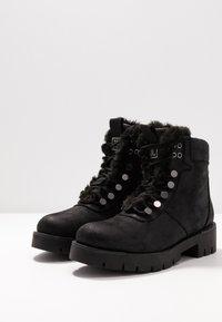 JETTE - Kotníkové boty na platformě - black - 4