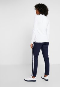 Polo Ralph Lauren Golf - SOFT POCKET PANT - Trousers - french navy/pure white - 2