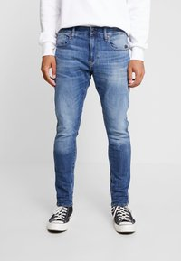 G-Star - REVEND SKINNY - Jeans slim fit - elto superstretch medium indigo aged - 0