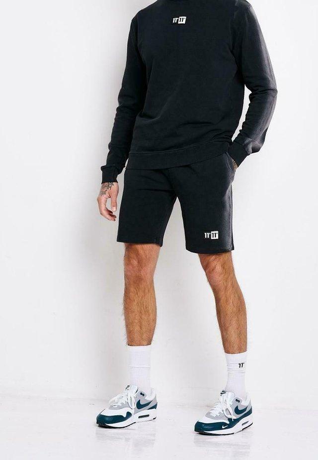 HEAT STROKE - Shorts - black
