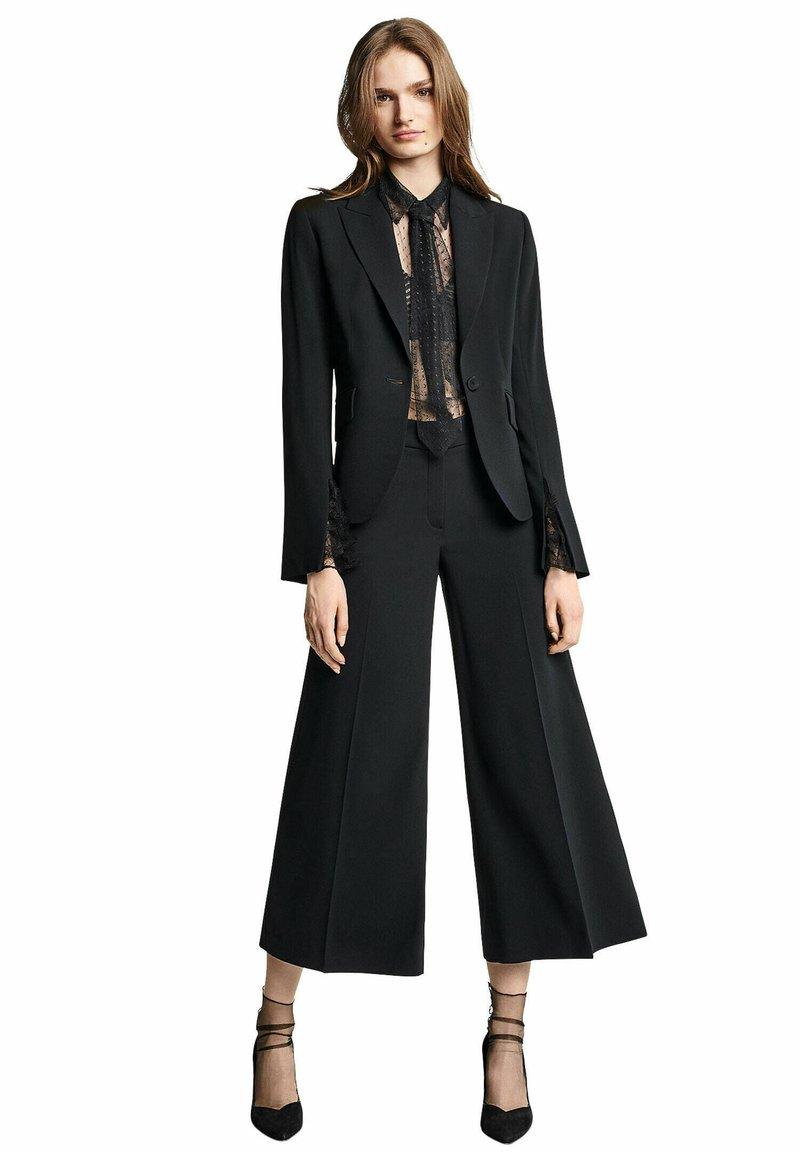 RIANI - Trousers - schwarz