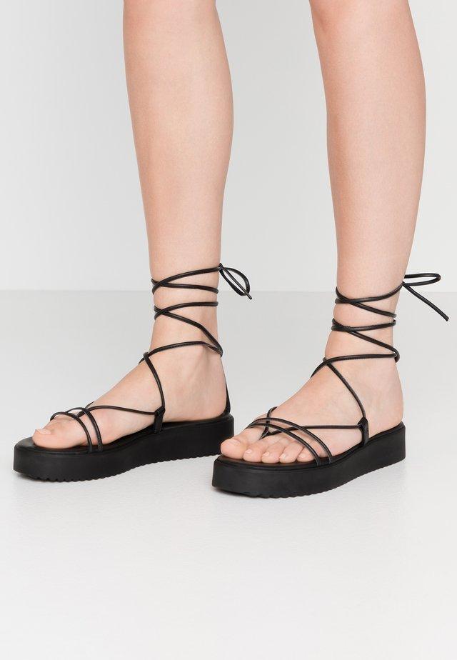 SKINNY - Sandalias con plataforma - black