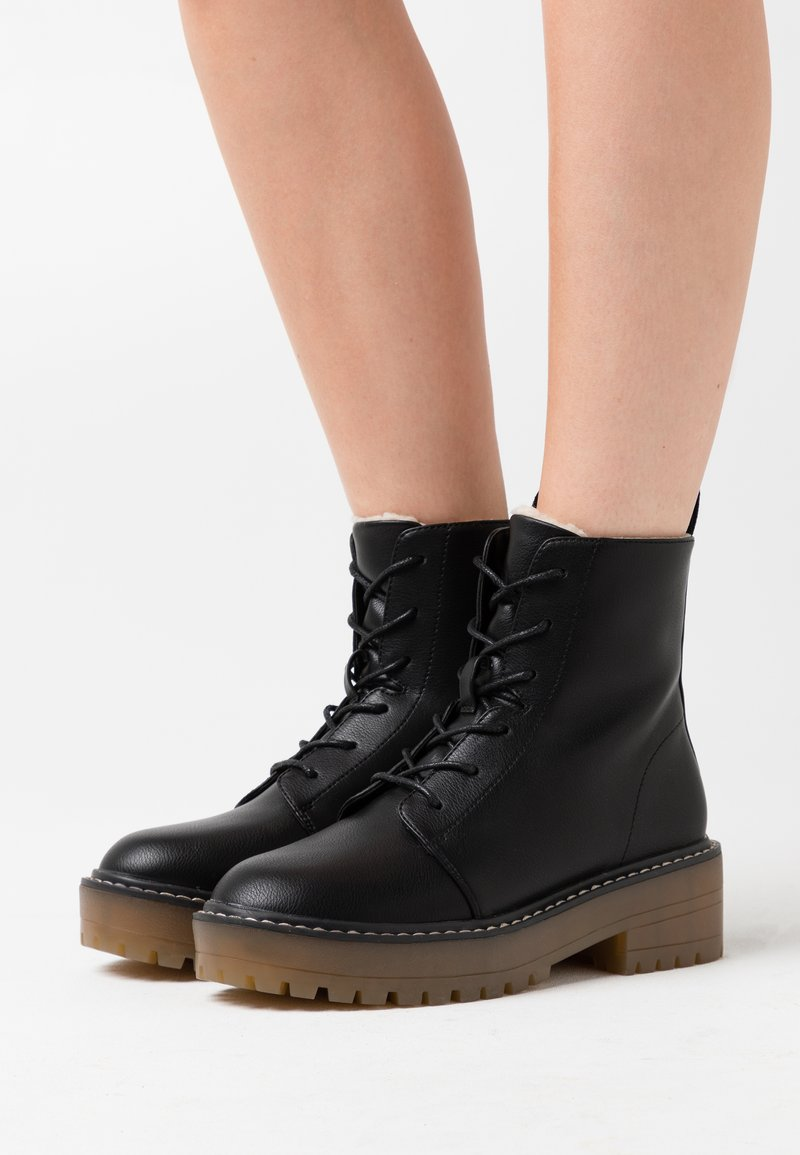 ONLY SHOES - ONLBRANDY LACE UP WINTER BOOT - Platform ankle boots - black