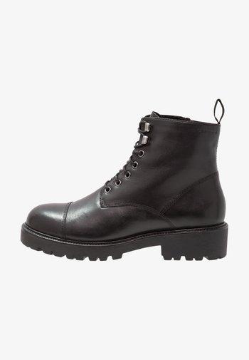 KENOVA - Platform ankle boots - black