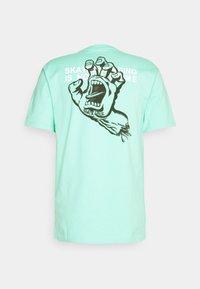 Santa Cruz - CRIME HAND UNISEX  - Print T-shirt - jade green - 1