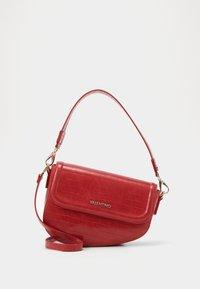 BICORNO - Handbag - rosso