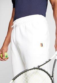 Nike Performance - PANT HERITAGE - Tracksuit bottoms - white - 5