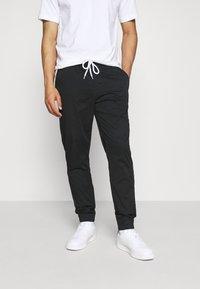 Champion Rochester - ELASTIC CUFF PANTS - Pantaloni sportivi - black - 0