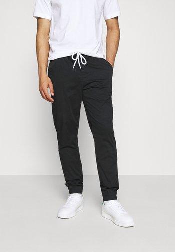 ELASTIC CUFF PANTS - Tracksuit bottoms - black