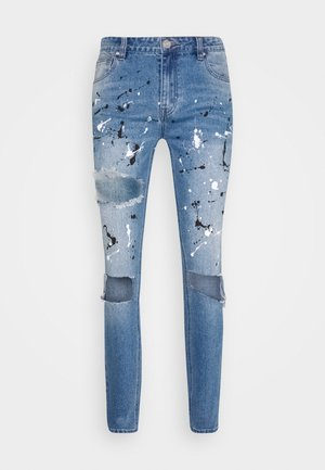 PAINT SPLATTER RIPPED - Vaqueros pitillo - blue