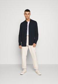 Calvin Klein - STAND COLLAR LIQUID TOUCH - Shirt - blue - 1