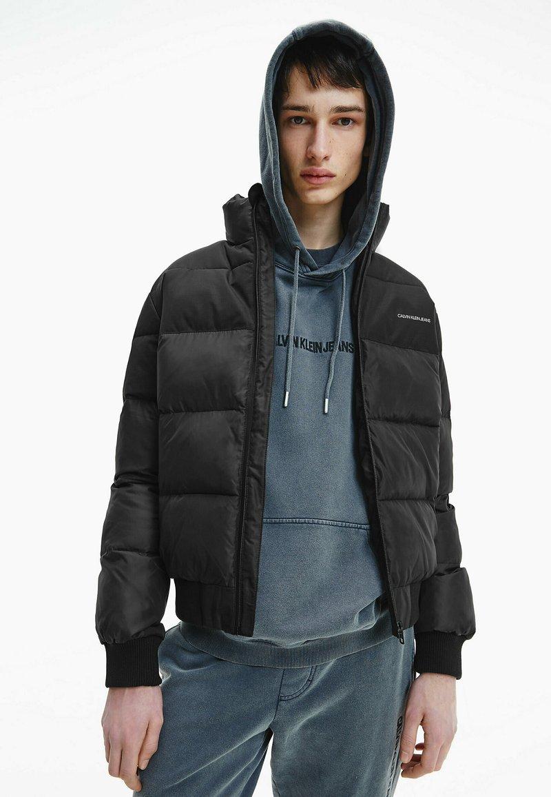 Calvin Klein Jeans - Winter jacket - ck black / mix media