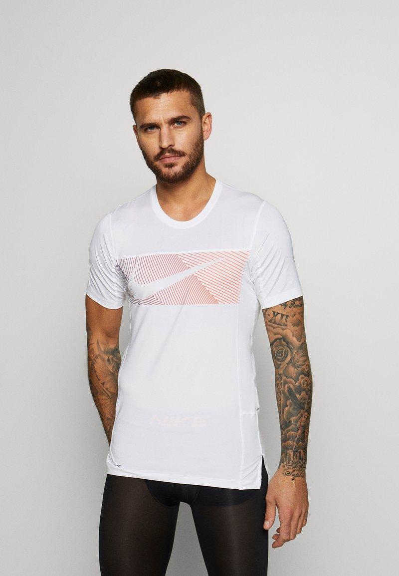 Nike Performance - Print T-shirt - white/black