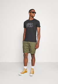 Marc O'Polo - SHORT SLEEVE CREW NECK ARTWORK ON CHEST - Print T-shirt - black - 1
