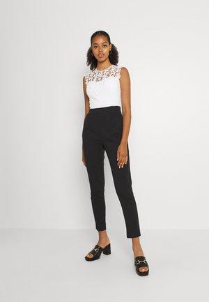 HAJAR - Jumpsuit - black/white