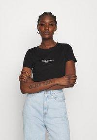 Calvin Klein - SLIM FIT 2 PACK - T-shirt z nadrukiem - black/bright white - 3
