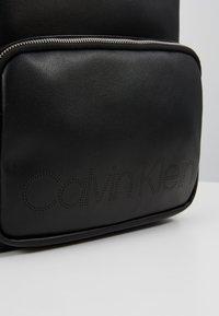 Calvin Klein - PUNCHED ROUND  - Rucksack - black - 7