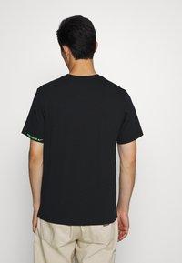 Nike Sportswear - TEE WORLDWIDE - Print T-shirt - black - 2