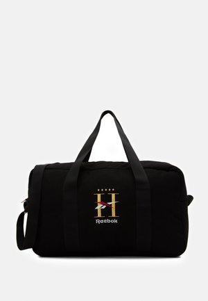 HOTEL GRIP UNISEX - Sports bag - black