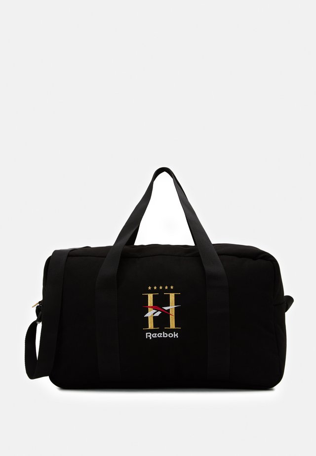 HOTEL GRIP UNISEX - Sports bag - black