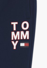 Tommy Hilfiger - GRAPHIC - Tracksuit bottoms - blue - 3
