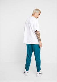 Nike Sportswear - TEARAWAY  - Pantalones deportivos - geode teal/sail - 2